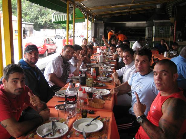 Too many people at this table, third guy on left is Napão